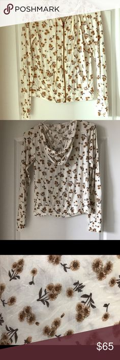 SUPER RARE Brandy Melville light zip up sweatshirt SUPER RARE Brandy Melville light weight, flower patterned, zip up sweatshirt. Very soft, and has a hood as well as pockets in the front. One size, but on the smaller end. Brand new without tags. Brandy Melville Sweaters Cardigans