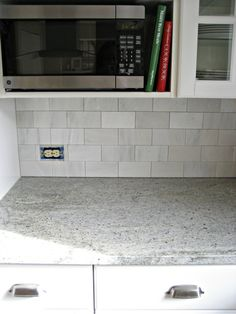 The tiles are the Hampton Carrara 3×6 subway tile in satin finish from the Tile Shop