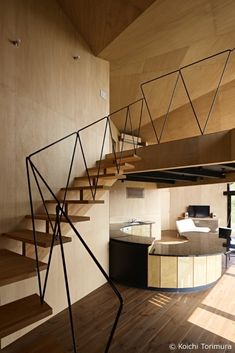 """Takeshi Hirobe Architects designed Villa Escargot on a hill with trees layering the back of the cliff-located property in Chiba, Japan. Facing the sea just 200 meters away, the house boasts. Interior Stairs, Interior Architecture, Interior And Exterior, Interior Design, Modern Exterior, Stair Handrail, Staircase Railings, Staircases, Banisters"