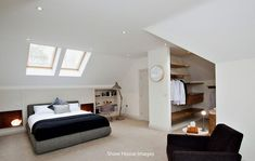 photo of beige white loft conversion with wall clock