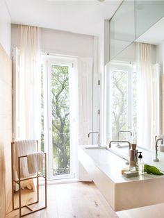 Modern bathroom with wood-clad wall and french doors via @thouswellblog