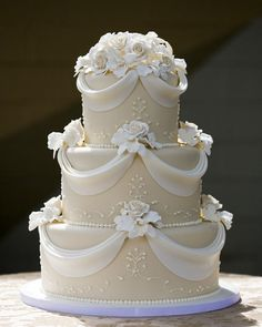"According to Bridal Guide magazine when Queen Elizabeth II and Prince Philip married in 1947 their wedding cake was nine feet tall and weighed 500 pounds. The royal couple even cut the cake with Prince Philip�s sword. It might not be 500 pounds but this cake looks pretty ""royal"" don't you think? #SimplyModernBridal #weddingcakes"