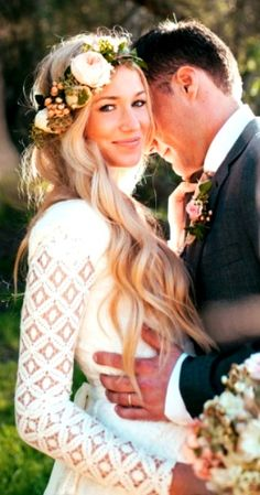 Love the flower crown. Hate her dress (its too boho) Mine is classic and simple