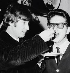 John feeding Roy Orbison, 1963.