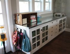 This galvanized steel countertop idea from The Pleated Poppy is a half and half DIY project. The countertop base was DIY'd but Poppy found a heating duct shop that fabricated a countertop for a very affordable $166.     credit: The Pleated Poppy [http://thepleatedpoppy.com/2011/02/galvanized-countertop/]