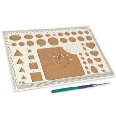 Deluxe Quilling Board and Tool. This looks excellent compared to simple ones I've seen in the past. Out of stock at Amazon. I'll go search elsewhere for it - it's made by Siesta Frames.