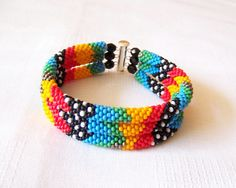 Was $60.00 Now $36.00    This bead crochet rope bracelet is made from czhech seed beads.    It will be perfect to create a unique look for yourself both