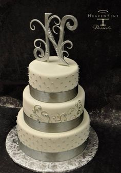 Silver and white classic yet simple wedding cake