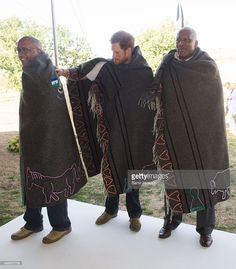 Prince Seeiso of Lesotho, Prince Harry and King Letsie III of Lesotho wear shawls given to them as a gift as they attend the opening of Sentebale's Mamohato Children's Centre during an official visit to Africa on November 26, 2015 in Maseru, Lesotho.