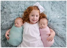 Had to share one sweet picture of these three while I work on the rest. She's already such a great big sister. :)