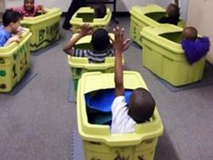 Pods designed for students with special needs. Each child has his or her own personal space, which can be outfitted with any sensory comforts that the child might need. Plastic tubs