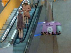 Kenzo Fashion Show on an escalator runway....