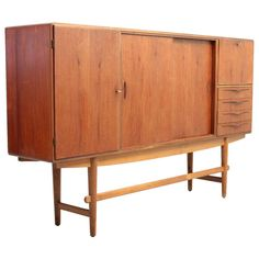 Large Teak And Oak Credenza Produced In Denmark Around 1950 | From a unique collection of antique and modern sideboards at http://www.1stdibs.com/furniture/storage-case-pieces/sideboards/