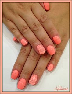 Coral peach nails with pixies