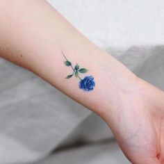 Rose tattoo is such a wonderful idea for all the women in the world if they want to have a floral tattoo. The reason is because the rose flower is gorgeous and Blue Ink Tattoos, Blue Flower Tattoos, Blue Tattoo, Mini Tattoos, Cute Tattoos, Beautiful Tattoos, Body Art Tattoos, Small Tattoos, Danty Tattoos