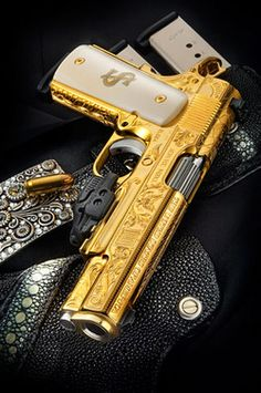 Love this gold 1911 (yuck on that $ sign though...makes it seem gaudy).