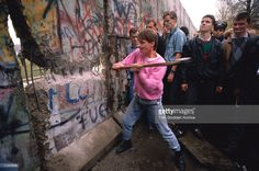 The first section of the Berlin Wall is torn down by crowds on the morning of November 10th 1989.