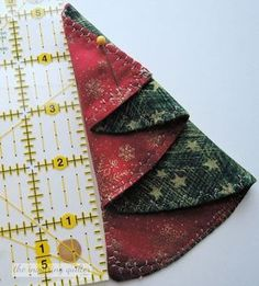 Day Seven: Folded Fabric Christmas Tree Ornament — The Inquiring Quilter. This best photo collections about Day Seven: Folded Fabric Christmas Tree Fabric Christmas Decorations, Christmas Tree Napkins, Quilted Christmas Ornaments, Fabric Christmas Trees, Christmas Tree Pattern, Christmas Tree Cards, Christmas Sewing, White Christmas, Christmas Quilting