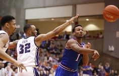 Kansas guard Wayne Selden Jr. (1) throws a pass to the wing as he is defended by TCU Horned Frogs guard Trey Zeigler (32) during the second half at Wilkerson-Greines Activity Center on Wednesday, Jan. 28, 2015 in Fort Worth, Texas.