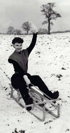 Audrey Hepburn goes sledding.