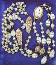 Cream Coloured Mummy Bead, Scarab and Large Scarab Pendant Neiger Necklace.  Photograph by the Neiger Collectors Club.