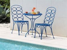 Round Blue Wrought Iron Bistro Table Added By Double Carving Chairs With Back of Enchanting Wrought Iron Bistro Set To Be Placed Balcony Chairs, Patio Dining Chairs, Bistro Chairs, Side Chairs, Iron Accessories, Bistro Set, Outdoor Furniture Sets, Outdoor Decor, Small Patio