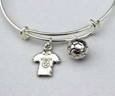 THIS LISTING IS FOR: - PICTURE #1 - Soccer Jersey and round soccer ball Adjustable Bangle Bracelet Soccer Themed. Alex and Ani Inspired