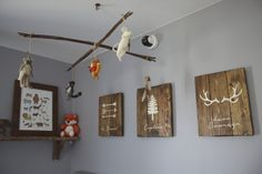 Project Nursery - Reclaimed Wood Signs over the Crib in this Woodland Nursery