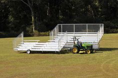 This is kind of handy. Portable bleachers than be towed around for different events. Cheaper than buying a buy of bleachers for each spot.