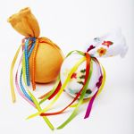 No-sew baby rattle: Mismatched baby booties  Cotton batting  Bell (ex. plastic cat ball with an enclosed jingle bell)  Ribbon