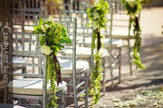 Green floral aisle decoration at ceremony site