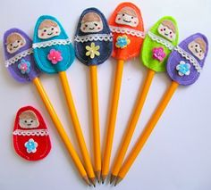 Pencil toppers - but I think they'd make cute hair clips for O