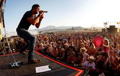 A sold-out crowd cheers as Luke Bryan performs on the Mane Stage.