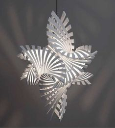 Bathsheba Grossman collaborated with MGX to produce symmetrical 3D Printed Lamps Based On Geometric Shapes ■ DesignTAXI.com