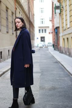 THE NAVY COAT Nanushka navy coat; H&M black flared jeans; Navy Wool Coat, Mango Bags, Black Suede Boots, Flare Jeans, Henna, Jumper, Two By Two, Asos, Normcore