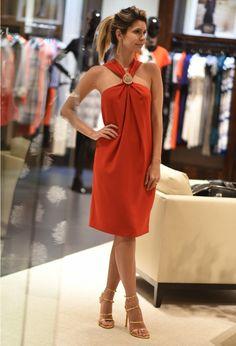 Brazilian style influencer Carol Tognon wears the Classic Cady Halter Dress.