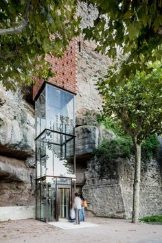Perforated brick elevator by Carles Enrich connects medieval Spanish town to riverside »