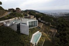 Barcelona-based architects Cadaval & Solà-Morales have designed the X-House. Completed in 2012, this contemporary home is situated on a very steep slope in Barcelona, Spain. Its unique x-shape was the result of solving numerous challenges associated with building on such terrain.