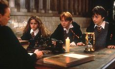 Year One: Harry Potter and the Philosopher's Stone. Professor Minerva McGonagall, Hermione Granger, Ron Weasley, and Harry Potter. (Movie)