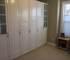 Murphy Bed with IKEA cabinets.  Would love to do this in the basement...