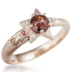 Shooting Star Light Engagement Ring - Look to the future with this asymmetrical design! This ring was originally inspired by and made for the organization Youth On Their Own. Bead-set diamonds accent the five points of the star.