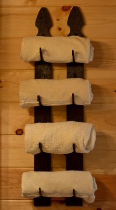 Towel rack made out of reclaimed fence post wood