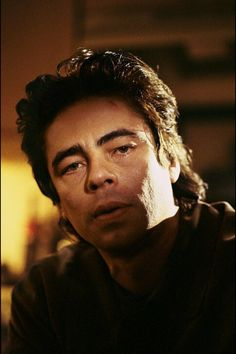 Benicio Del Toro for the hero or villain. The hunted and usual suspects says it all. He appeared in Snatch which had Jason Statham and License to Kill with Robert Davi.