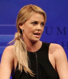 Charlize Therons low and loose ponytail