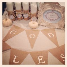 Baby boy baptism - covered dollar store candles in burlap, burlap God Bless sign for sweet table, tags on mini pumpkins from etsy shop greenbeansieink.
