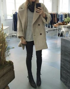 Black skinny jeans, striped breton top and camel coat.