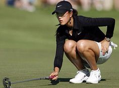 Michelle Wie showing how awesome simple black and white (or navy and white) look on golf course.