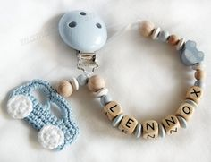 Pacifier chain clip Dummy holder, keeper personalized with name, crocheted car and wooden beads, light blue (item 1100). $15.90, via Etsy.