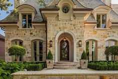Stone, arched doorway. Love the tall windows/doors. Would only want one step up to front door. Too many steps and it makes it difficult for older folks to get up. Vernham - traditional - exterior - toronto - Peter A. Sellar - Architectural Photographer