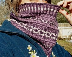 Cowloh3g_small2 Winter Arabesque Cowl is a good way to keep away the cold winter wind. The pattern comes with charts, photos, and written instructions.